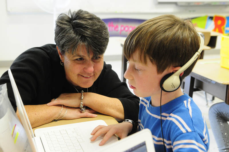 Principal Lori Smail chats with student Sam Goldey during a classroom visit Wednesday at Farrington School in Augusta.