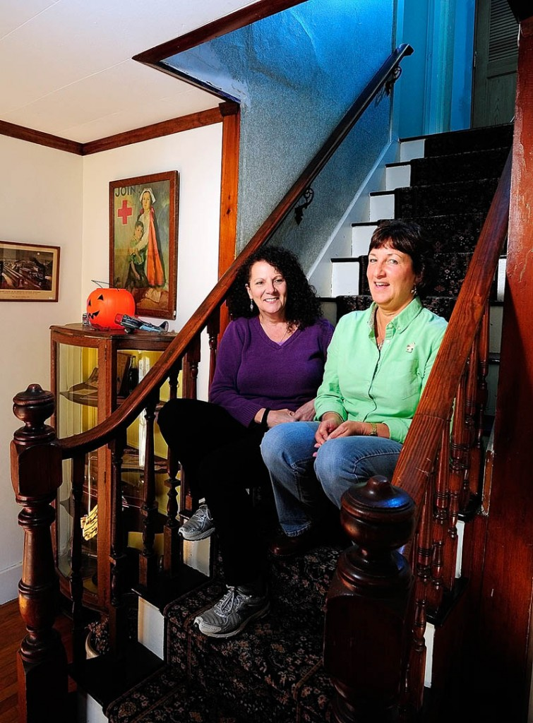 """Annette Parlin, a medium/clairvoyant, left, and Cathy Cook, author of """"Hauntings from Wayne and Beyond,"""" talk about the book on Wednesday at Cook's home in Wayne."""