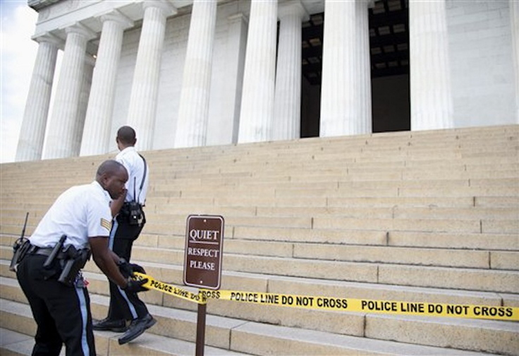 US Park Police officers pull police tape across the steps closing access to the Lincoln Memorial in Washington, Tuesday, Oct. 1, 2013. Congress plunged the nation into a partial government shutdown Tuesday as a long-running dispute over President Barack Obama's health care law stalled a temporary funding bill, forcing about 800,000 federal workers off the job and suspending most non-essential federal programs and services.