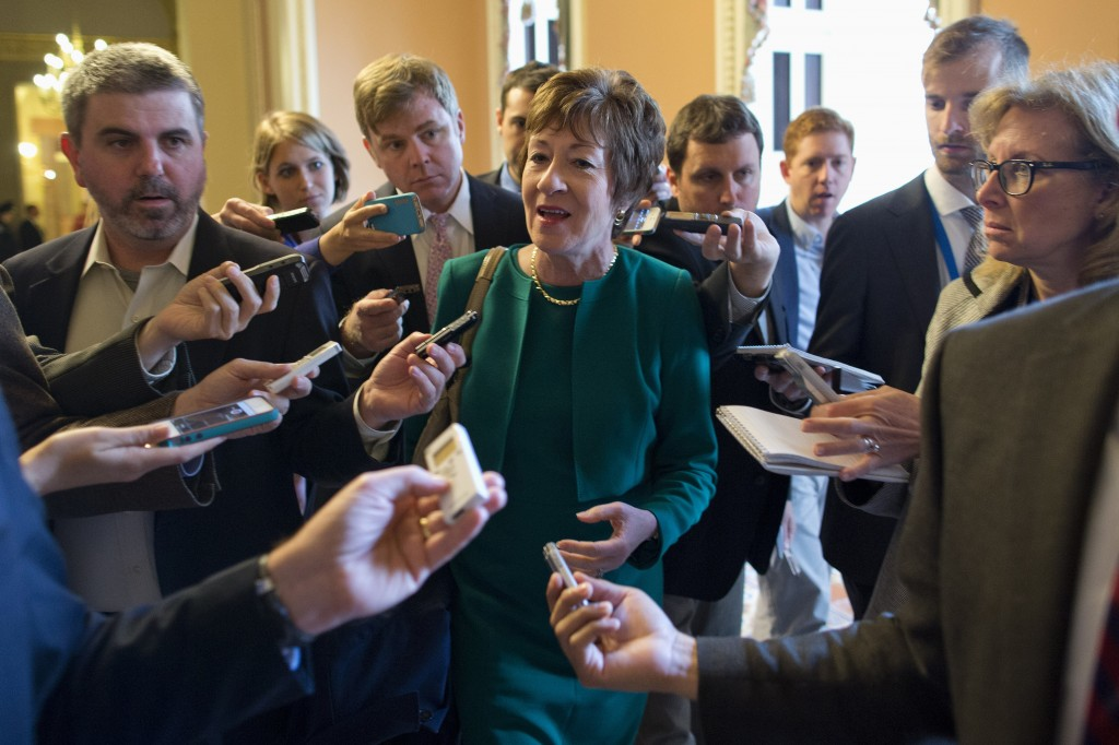 Sen. Susan Collins, R-Maine, talks with reporters after arriving on Capitol Hill in Washington on Friday following a meeting between Republican senators and President Obama at the White House on the ongoing budget battle.