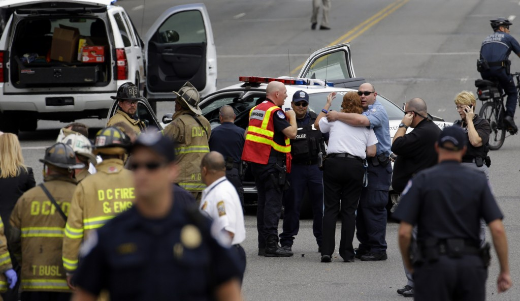 Police gather near where shots were fired on Capitol Hill in Washington on Thursday.