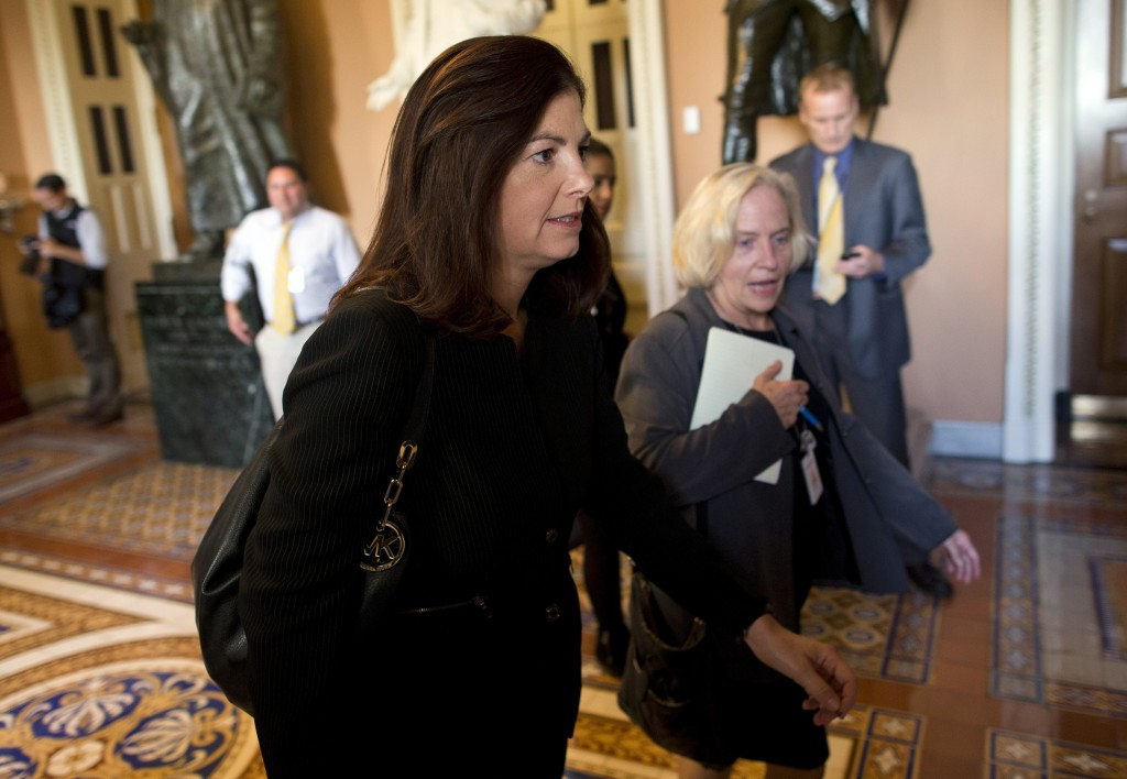 Sen. Kelly Ayotte, R-N.H., is one of 12 senators pushing both political parties toward a compromise that would reopen the government and raise the debt ceiling.