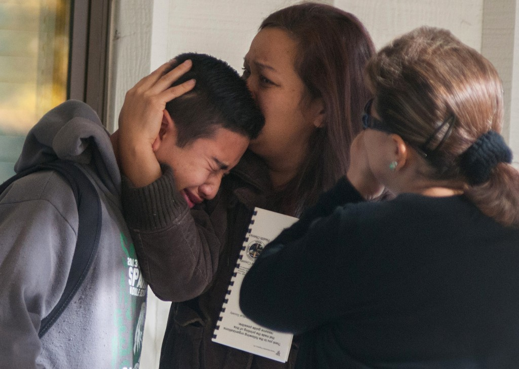 A Sparks Middle School student cries and is comforted after being released from Agnes Risley Elementary School, where some students were evacuated to after a shooting at Sparks Middle School in Sparks, Nev., on Monday.