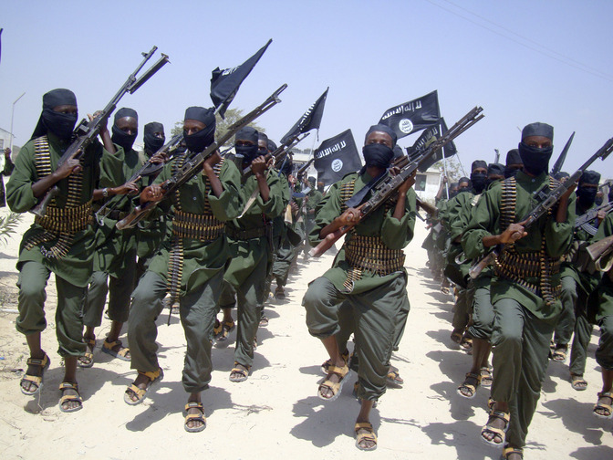In this Thursday, Feb. 17, 2011, photo, al-Shabab fighters march with their weapons during military exercises on the outskirts of Mogadishu, Somalia. Foreign military forces carried out a pre-dawn strike Saturday, Oct. 5, 2013, against foreign fighters in the same southern Somalia village where U.S. Navy SEALS four years ago killed a most-wanted al-Qaida operative, officials said.