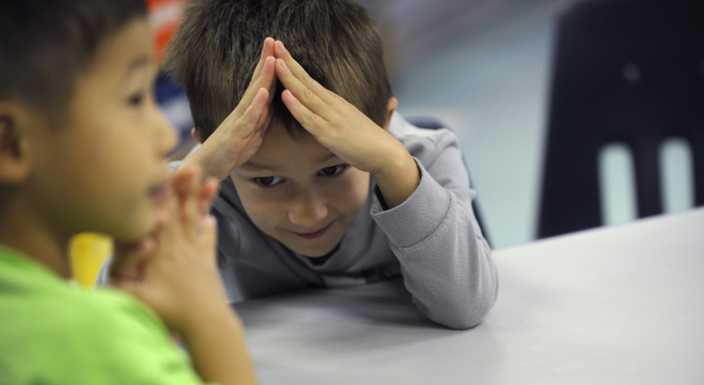 Tommy Henp, 5, left, and Preston Kirkendall, 5, learn sign language during a lesson at a homeschooling co-operative at Andrews Air Force Base, Md.