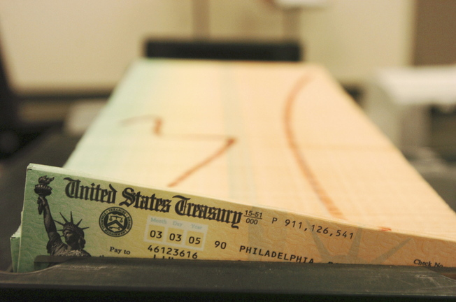 2005 Associated Press File Photo Trays of printed social security checks wait to be mailed from the U.S. Treasury's Financial Management services facility in Philadelphia. Millions of Social Security recipients can expect a historically small increase in benefits come January 2014.
