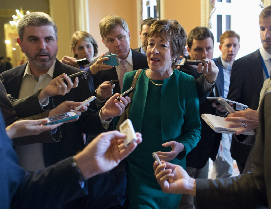 Sen. Susan Collins, R-Maine, talks with reporters after arriving on Capitol Hill following a meeting between Republican senators and the president.