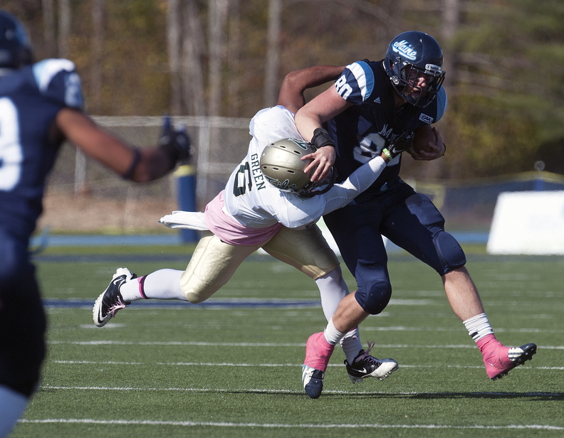 Maine receiver Justin Perillo (80) gets tackled by William and Mary linebacker Airek Green (6) after a reception in the first half of an NCAA college football game Saturday, Oct. 19, 2013, in Orono, Maine. (AP Photo/Michael C. York)