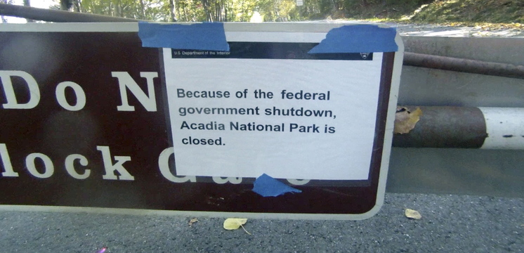 A sign on a closed gate near the entrance to the Park Loop Road in Acadia National Park tells visitors on Thursday that the park is closed because of the government shutdown.