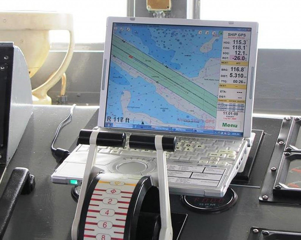A computer displays an electronic nautical chart aboard a ship.