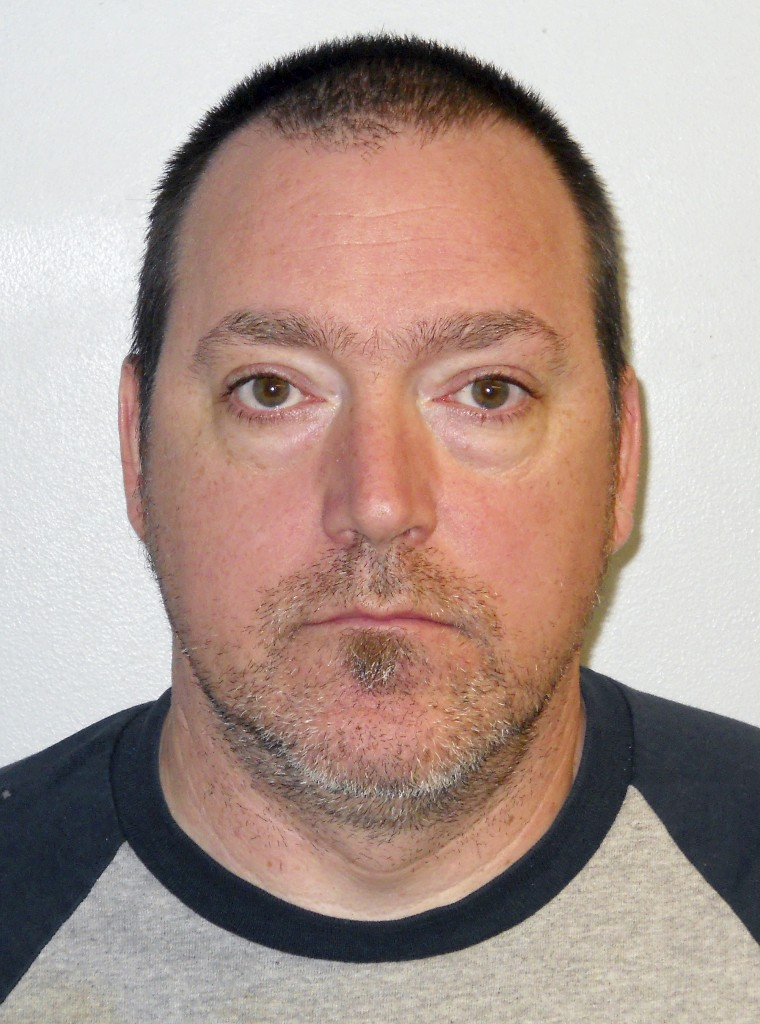 This booking photo released by the Concord Police Department shows Raymond Stevens, of Pembroke, N.H., arrested Tuesday, Oct. 15, 2013, on charges of criminal mischief after a two-year investigation into racist graffiti scrawled on the homes of several Concord, N.H., families originally from Africa. The messages were written in black permanent marker on the siding next to the main doors at each home. Police said Stevens lived in the neighborhood at the time.