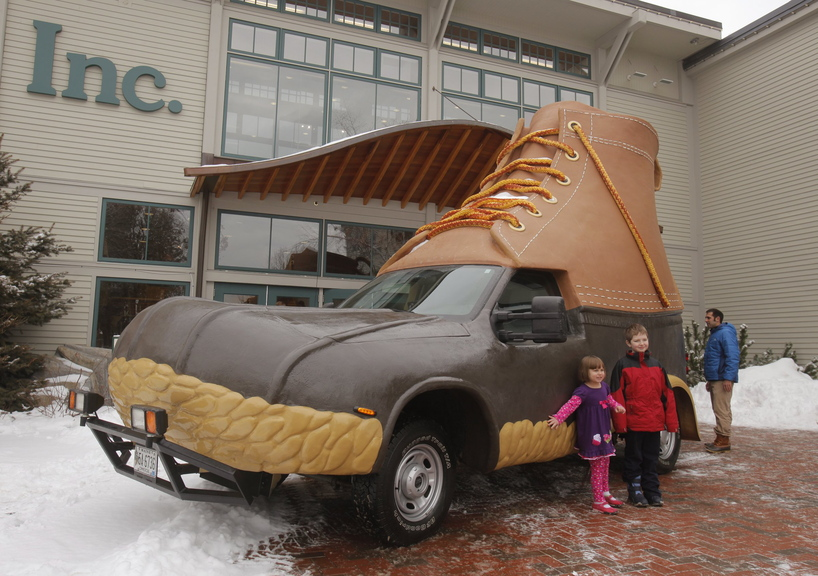 Children pose for a picture next to the L.L. Bean Bootmobile outside the main entrance to the company's flagship store in Freeport in January 2012. The Bootmobile will visit 15 college campuses this winter.