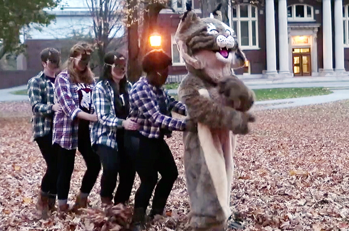 "In this screen capture from a video produced by Bates College, members of the Bates Modern Dancers follow a bobcat, the school mascot, through the Lewiston campus. The school's communications office says it made the video, ""to showcase the fun spirit and talent"" of Bates students. The video answers the question, ""What does the bobcat say?"""