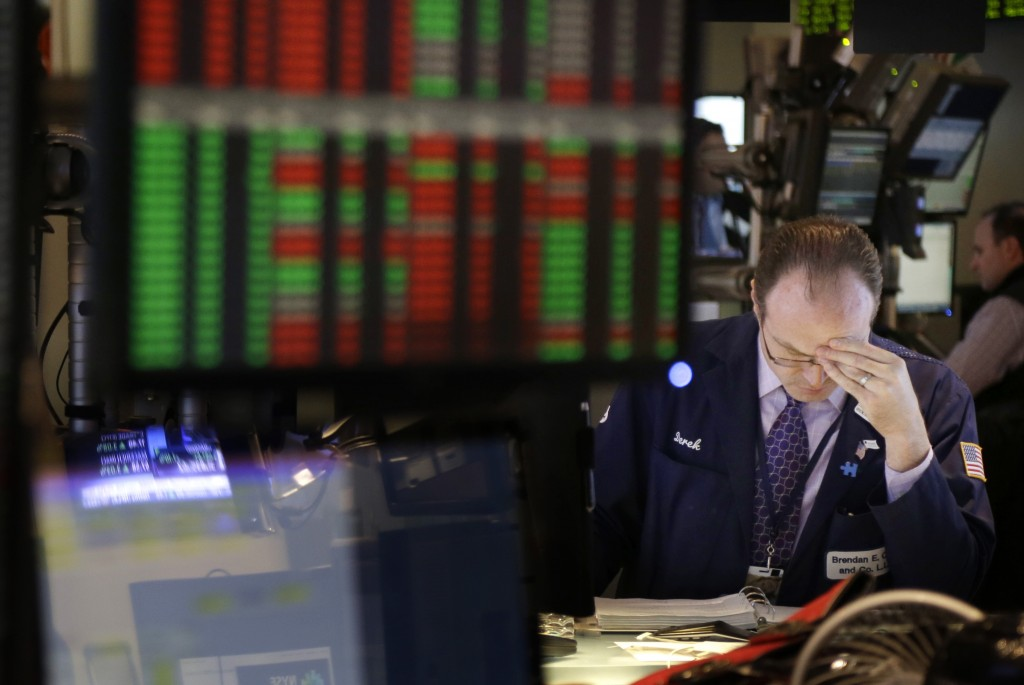 A trader works on the floor at the New York Stock Exchange in New York on Wednesday. Stocks surged after Senate leaders reached a deal that would avoid a U.S. default and reopen the government after 16 days of being partially shut down.