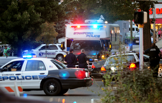 Law enforcement from local, state and federal jurisdictions investigate the residence of Miriam Carey in Stamford, Conn., on Thursday. Authorities have identified Carey, 34, as the woman who, with a 1-year-old child in her car, led Secret Service and police on a harrowing chase in Washington from the White House past the Capitol Thursday.