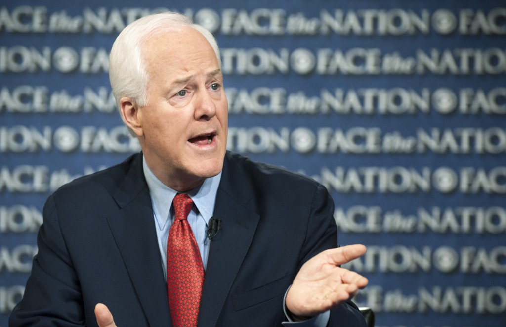 """In this photo provided by CBS News, Sen. John Cornyn, R-Texas, speaks on CBS's """"Face the Nation"""" in Washington on Sunday. Cornyn said the partial federal government shutdown cannot end without President Barack Obama sitting down with congressional Republicans.""""What he needs to do is to roll up his sleeves,"""" Cornyn said. """"We're not going to resolve this without the president engaging,"""" he said. """"So far, he's been AWOL,"""" he added."""