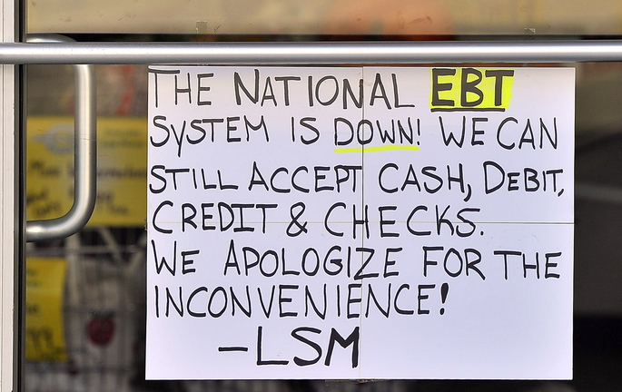Owners of Smaha's Legion Square Market in South Portland's Knightville put a sign on their door Saturday warning customers who use food stamp cards that they were unable to process card transactions. The problems, which occurred in 17 states where the program is operated by Xerox, was blamed on a computer glitch that was corrected later in the day.