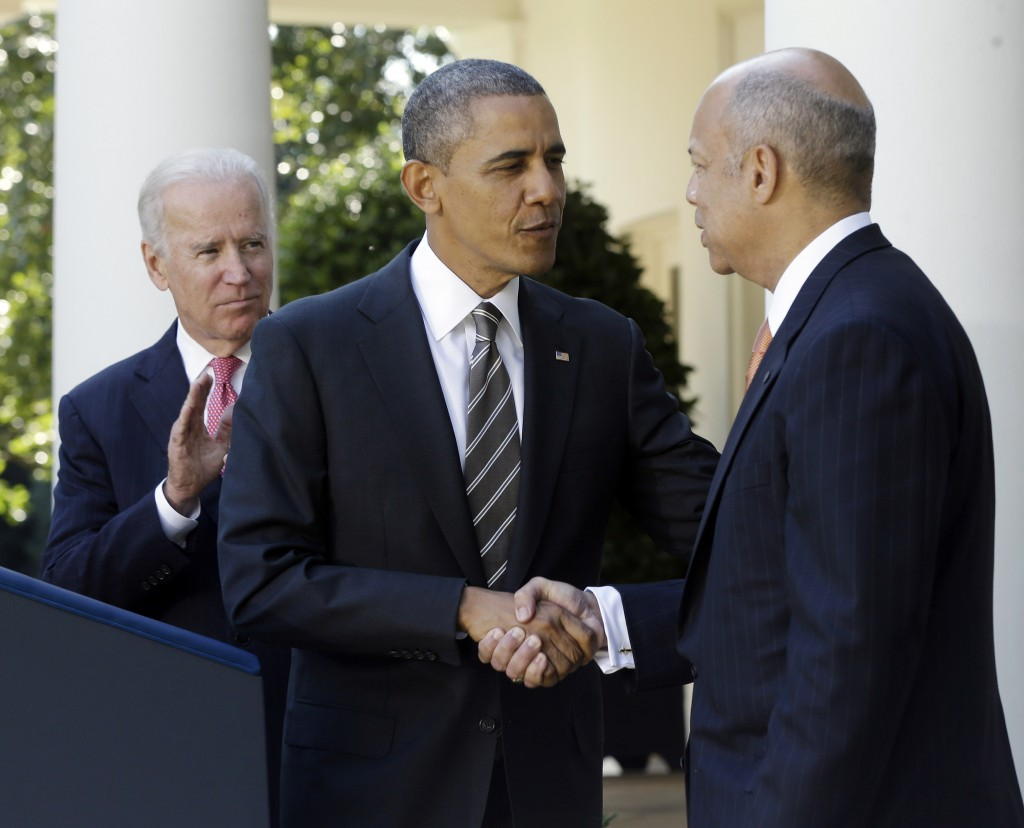 President Barack Obama, center, shakes hands with with Jeh Johnson, right, his choice for the next Homeland Security Secretary, as Vice President Joe Biden, left, applauds in the Rose Garden at the White House in Washington, Friday, Oct. 18, 2013. Johnson was general counsel at the Defense Department during the wars in Iraq and Afghanistan.