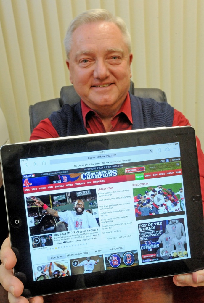 Up late: David Smith, branch manager for Raymond James Financial Services in Waterville, relaxes Thursday after staying up late to watch the Red Sox win the World Series.