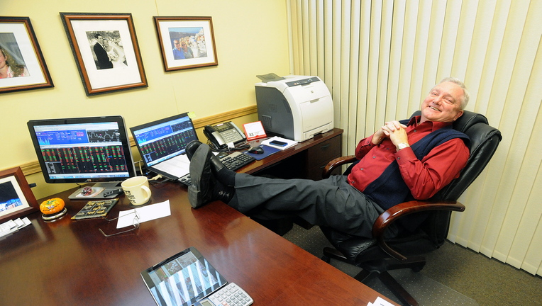 Up Late: David Smith, branch manager for Raymond James Financial Services in Waterville, relaxes Thursday staying up late to watch the Red Sox win the World Series.