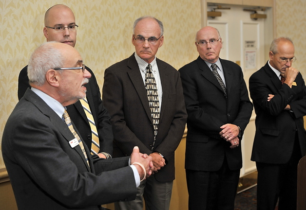 Rich Livingston, left, AARP's Maine volunteer state president, speaks as other association leaders look on, at a press conference held Saturday during the Maine Medical Association's annual meeting in Portland.