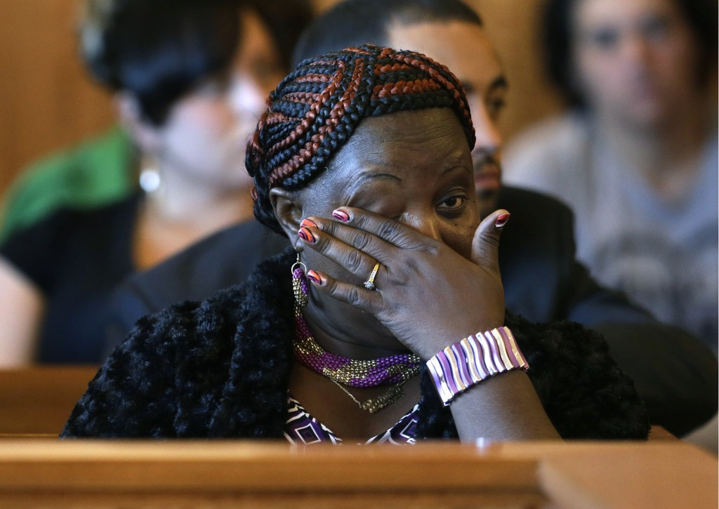 Ursula Ward, mother of murder victim Odin Lloyd, wipes away a tear during the arraignment of Shayanna Jenkins in superior court, in Fall River, Mass., Tuesday, Oct. 15, 2013. Jenkins, girlfriend of former New England Patriots' Aaron Hernandez, was arraigned on a perjury charge in connection with the killing of Lloyd. Authorities say she was untruthful in her testimony before the grand jury investigating his death.
