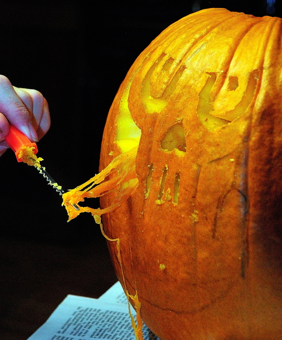 Halloween Art: Corey Boynton carves a pumpkin during the After School Art Program Wednesday at Johnson Hall in Gardiner.
