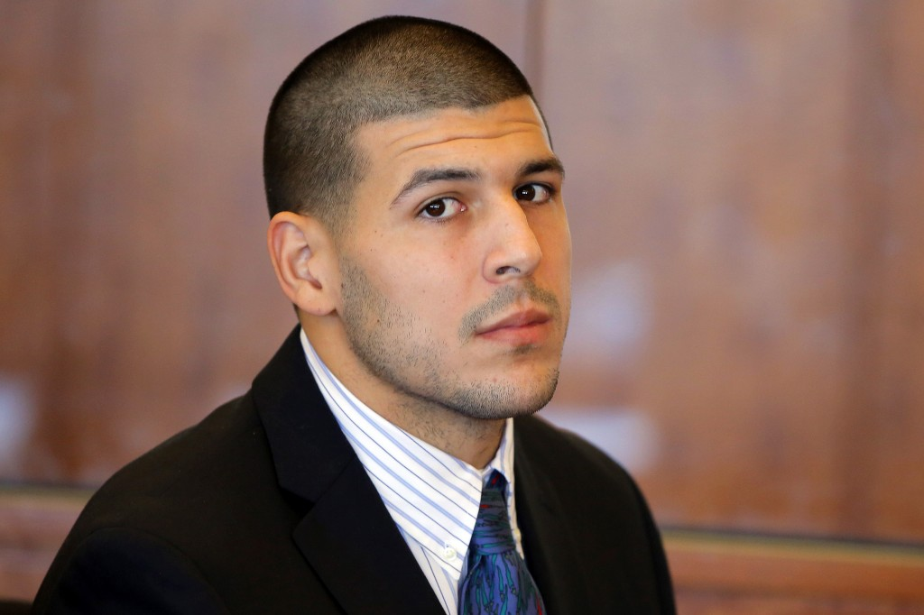 Former New England Patriots NFL football player Aaron Hernandez attends a pretrial court hearing in Fall River, Mass. on Wednesday, Oct. 9, 2013. Hernandez was indicted in August in the killing of 27-year-old Odin Lloyd, a semi-professional football player from Boston who was dating the sister of Hernandez's girlfriend. He has pleaded not guilty. (AP Photo/Brian Snyder, Pool)