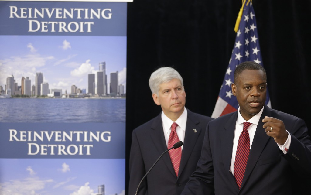 Kevyn Orr, right, state-appointed emergency manager for Detroit, and Michigan Gov. Rick Snyder hold a news conference about the city's bankruptcy in Detroit in July.