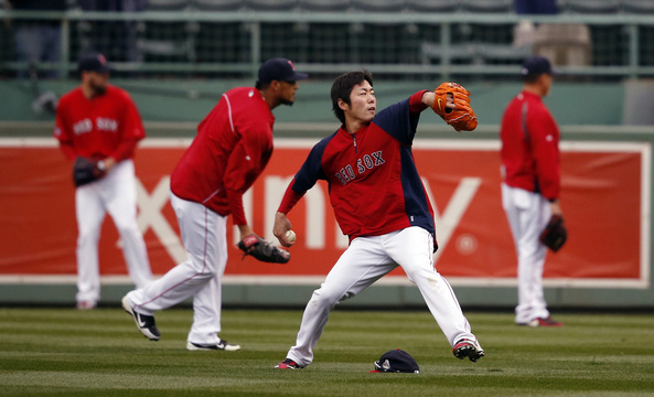 Boston Red Sox's Koji Uehara throws with teammates before Game 1 of baseball's World Series against the St. Louis Cardinals Wednesday, Oct. 23, 2013, in Boston.