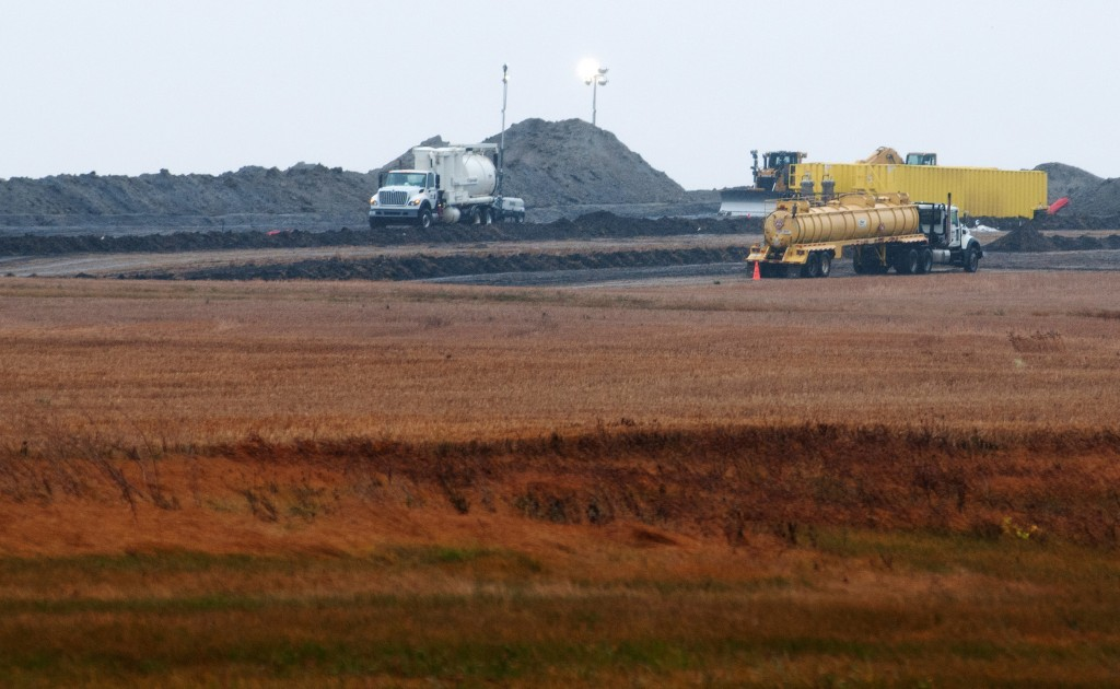 Cleanup continues at the site of an oil pipeline leak and spill north of Tioga, N.D., on Oct. 11.