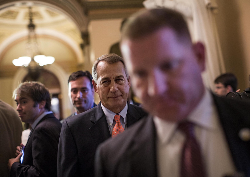 "House Speaker John Boehner, R-Ohio, leaves the House floor after votes on Saturday in Washington. On ABC's ""This Week"" program Sunday, he said President Obama ""is risking default by not having a conversation with us."""