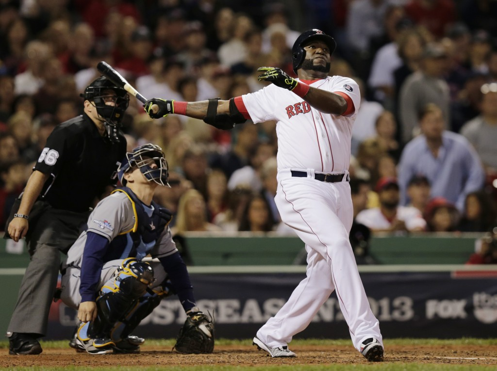 Boston Red Sox designated hitter David Ortiz watches his second home run of the game off Tampa Bay Rays starting pitcher David Price, in front of Rays catcher Jose Molina in the eighth inning in Game 2 of baseball's American League division series Saturday, Oct. 5, 2013, in Boston.