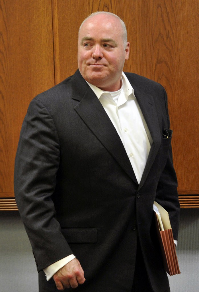 In this April 30, 2013 file photo, Michael Skakel leaves the courtroom after the conclusion of trial regarding his legal representation at State Superior Court in Vernon, Conn. A Connecticut judge on Wednesday, Oct. 23, 2013, granted a new trial for Skakel, ruling his attorney failed to adequately represent him when he was convicted in 2002 of killing his neighbor in 1975.