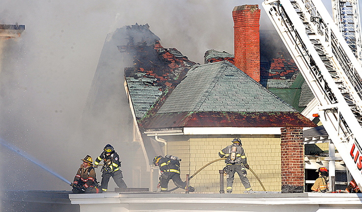Firefighters battle a blaze that heavily damaged three apartment buildings in downtown Lewiston on April 29 . The confession of the boy charged with starting the fire has been thrown out by a judge.