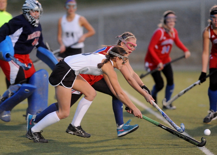 Staff photo by Michael G. Seamans Skowhegan Area High School's Brooke Michonski, 8, battles for the ball with Messalonskee High School's Riley Field, 10, in the first half in the Eastern Maine Class A championship game at Hamden Academy on Tuesday. Skowhegan defeated Messalonskee 1-0.
