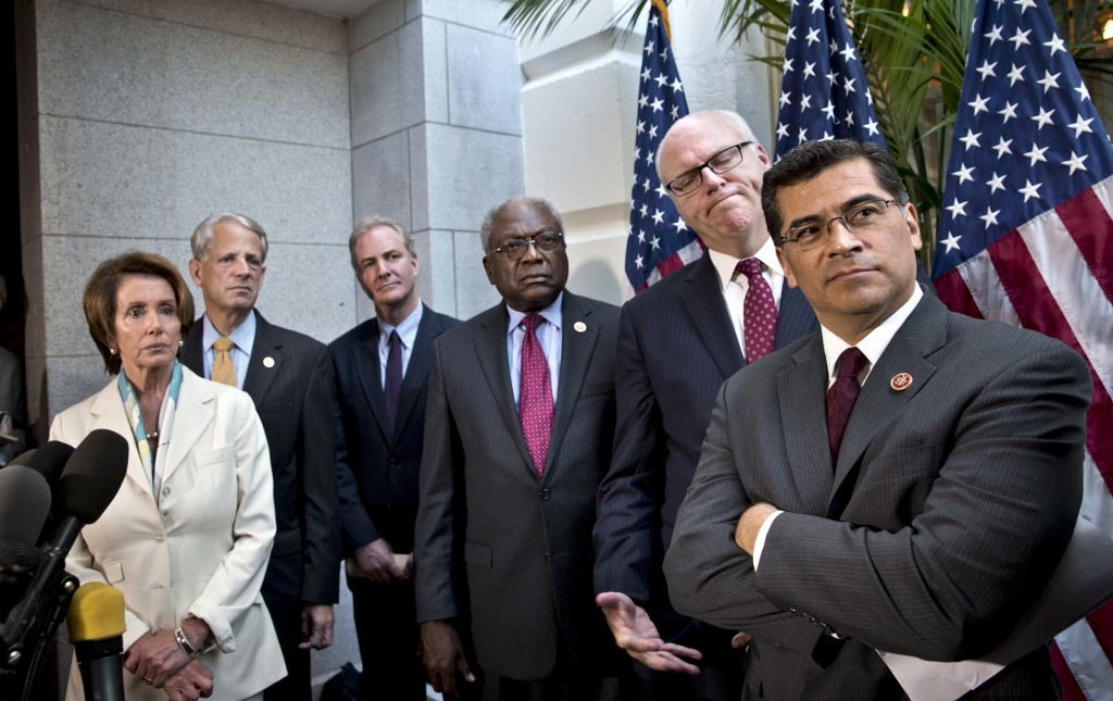 From left, House Minority Leader Nancy Pelosi, D-Calif., Rep. Steve Israel, D-N.Y., Rep. Chris Van Hollen, D-Md., Assistant Minority Leader James Clyburn, D-S.C., Rep. Joseph Crowley, D-N.Y., and Rep. Xavier Becerra, D-Calif., listen to a question during a news conference at the Capitol in Washington, Tuesday, Oct. 15, 2013. The partial government shutdown is in its third week and less than two days before the Treasury Department says it will be unable to borrow and will rely on a cash cushion to pay the country's bills.
