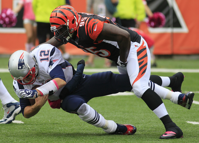 Patriots quarterback Tom Brady is sacked by Bengals defensive end Wallace Gilberry in the first half Sunday Cincinnati.