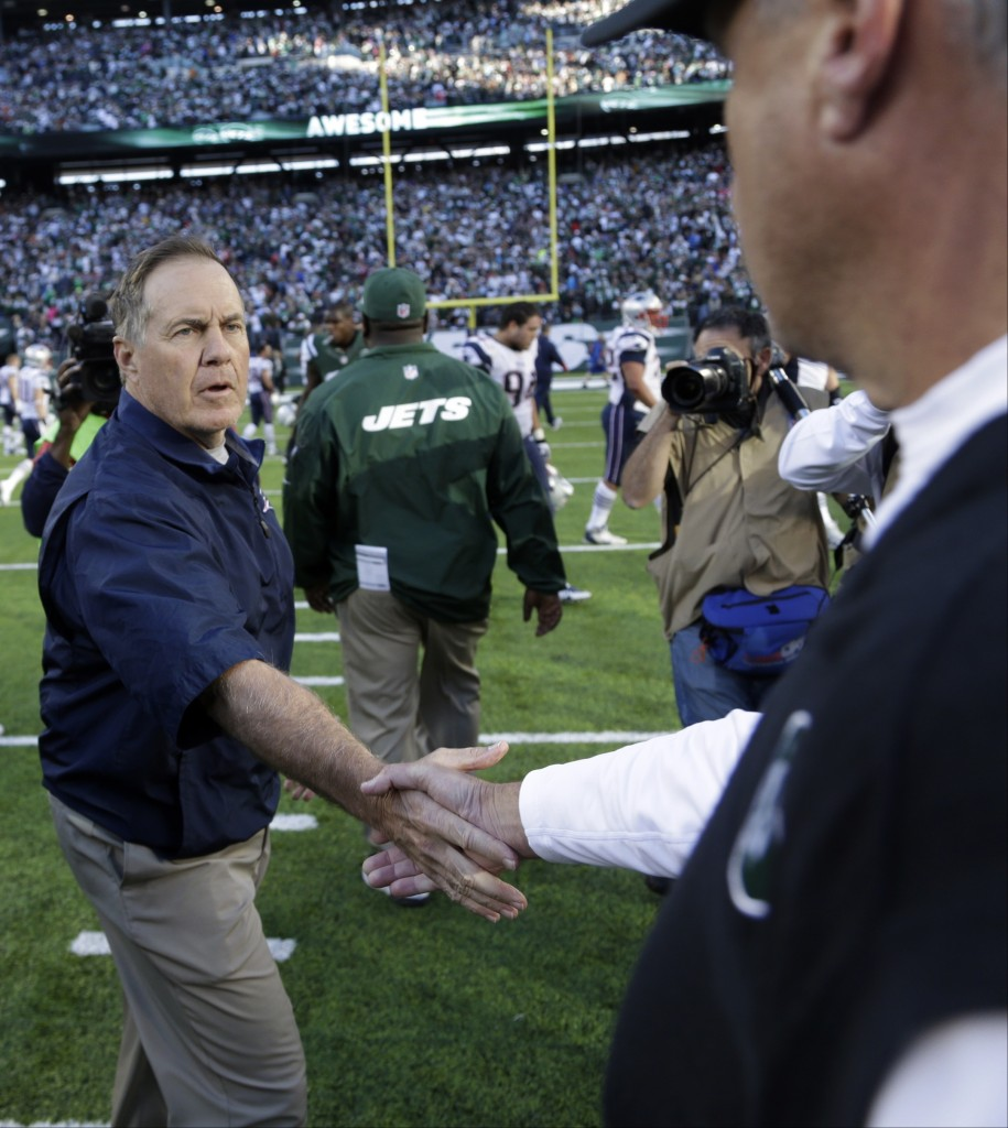 New England Patriots head coach Bill Belichick shakes hands with New York Jets head coach Rex Ryan after an NFL football game Sunday, Oct. 20, 2013 in East Rutherford, N.J. The Jets won the game 30-27.