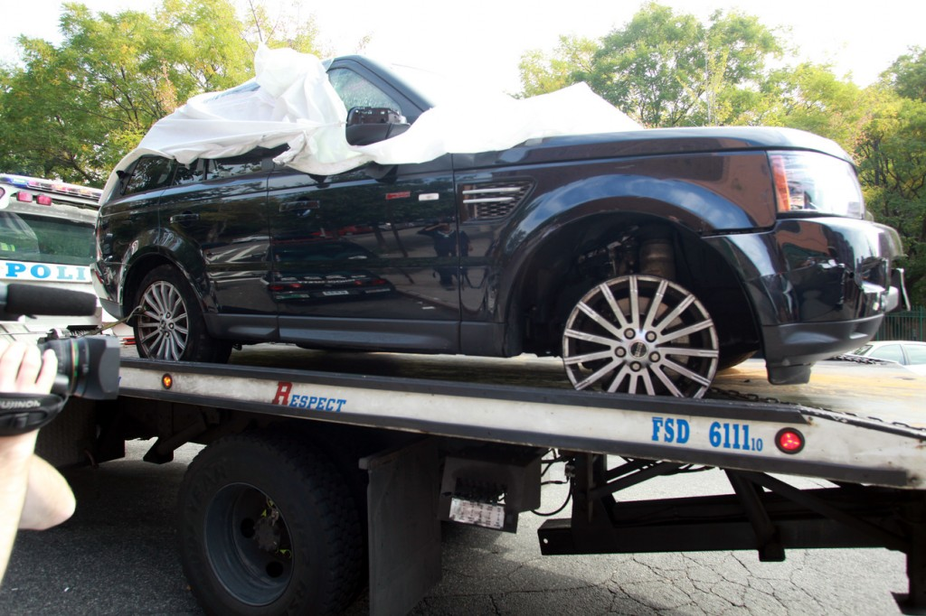 The Range Rover involved in the bikers attack is being moved from the police precinct for further police investigation on Oct. 5, 2013, in New York.