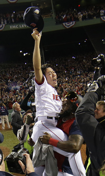 Boston Red Sox's David Ortiz lifts relief pitcher Koji Uehara after Boson defeated the St. Louis Cardinals in Game 6 of baseball's World Series Wednesday, Oct. 30, 2013, in Boston. The Red Sox won 6-1 to win the series. (AP Photo/Matt Slocum)