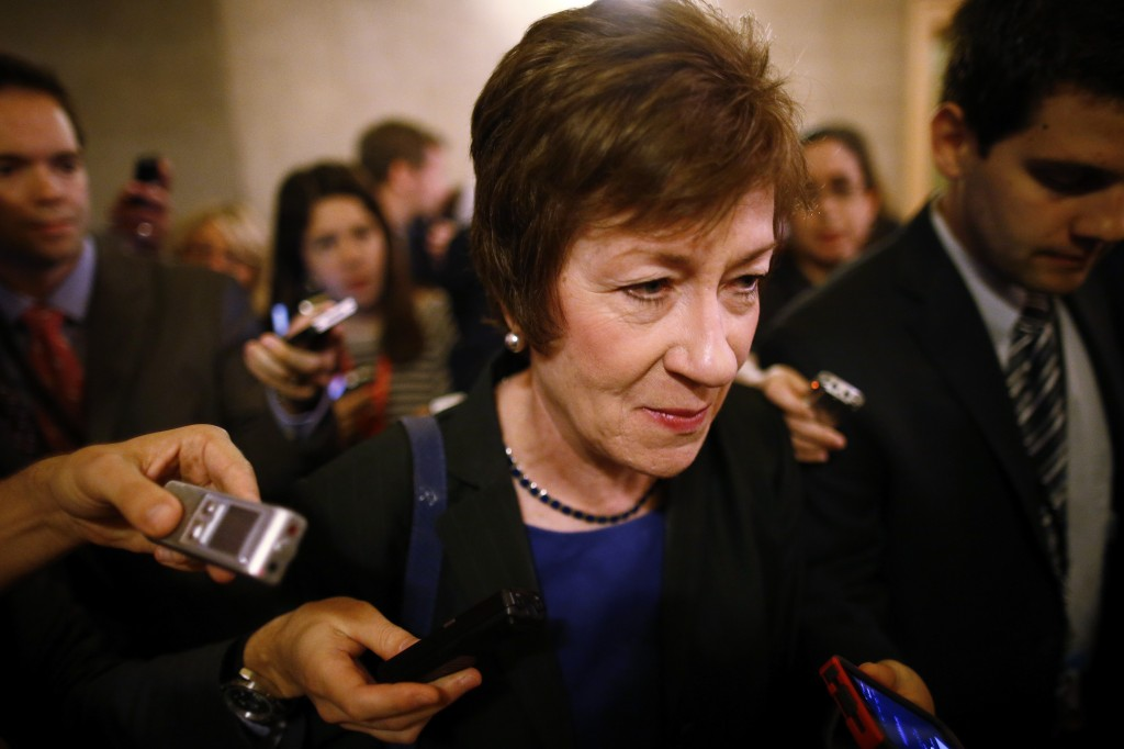 Sen. Susan Collins, R-Maine, is followed by reporters as she leaves a meeting of Senate Republicans regarding the government shutdown and debt ceiling on Capitol Hill in Washington on Saturday.