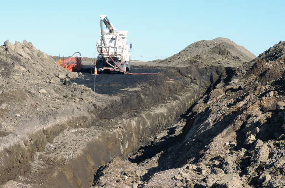 In this Oct. 8, 2013, photo provided by the North Dakota Health Department, a vacuum truck cleans up oil near Tioga, N.D. Officials say the 20,600-barrel spill, among the largest recorded in the state, was discovered on Sept. 29 by a farmer harvesting wheat about nine miles south of Tioga.