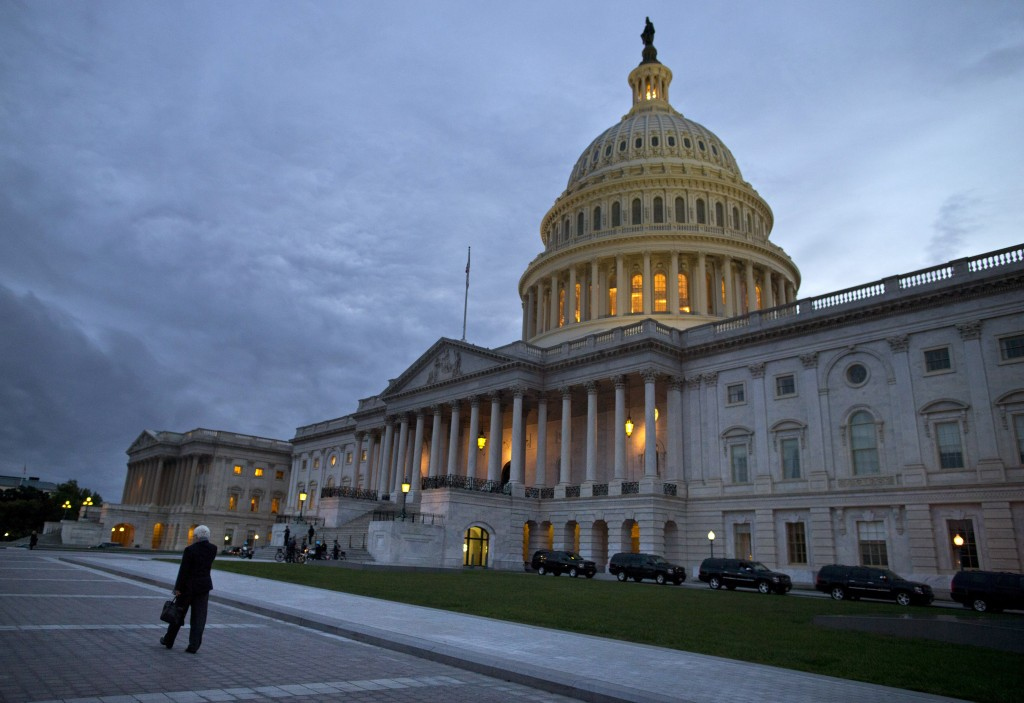 This Oct. 15, 2013, photo, shows a view of the U.S. Capitol building at dusk in Washington. Even if Congress reaches a last-minute or deadline-busting deal to avert a federal default and fully reopen the government, elected officials are likely to return to their grinding brand of brinkmanship, perhaps repeatedly. House-Senate talks are barely touching the underlying causes of debt-and-spending stalemates that pushed the country close to economic crises in 2011, last December and again this month.