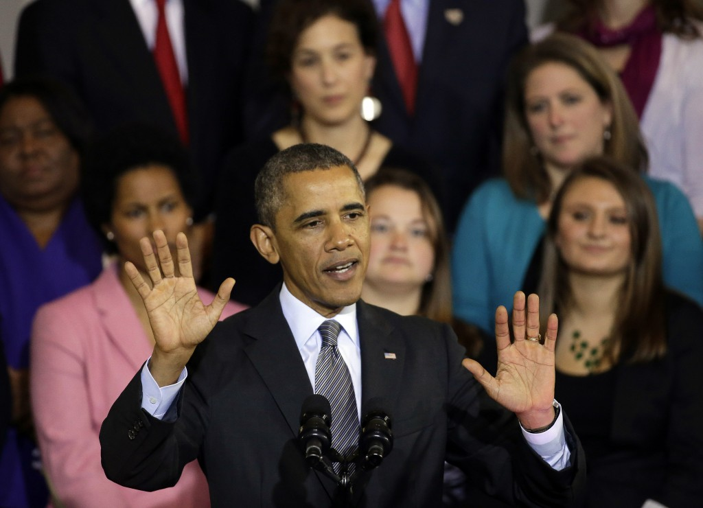 President Barack Obama speaks at Boston's historic Faneuil Hall about the federal health care law on Wednesday. Faneuil Hall is where former Massachusetts Republican Gov. Mitt Romney, Obama's rival in the 2012 presidential election, signed the state's landmark health care law in 2006, with top Democrats standing by his side.