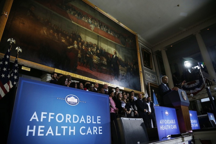 President Barack Obama speaks at Boston's historic Faneuil Hall about the federal health care law, Wednesday, Oct. 30, 2013. Faneuil Hall is where former Massachusetts Gov. Mitt Romney, Obama's rival in the 2012 presidential election, signed the state's landmark health care law in 2006, with top Democrats standing by his side.
