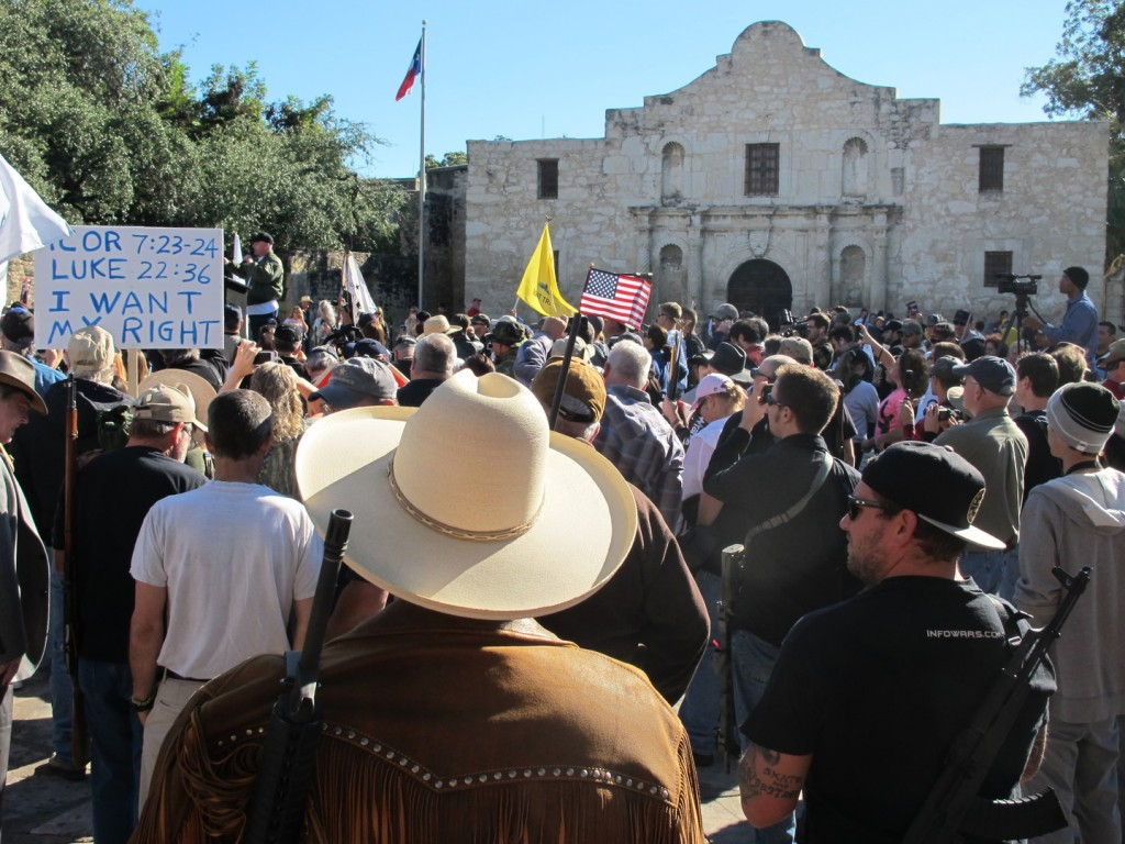 Gun rights advocates gather at the Alamo in San Antonio, Texas on Oct. 19, 2013 to demonstrate in support of a Texas law that permits the open carry of long arms, such as rifles and shotguns. Organizers said a local ordinance restricting the carrying of firearms in public conflicts with state law.