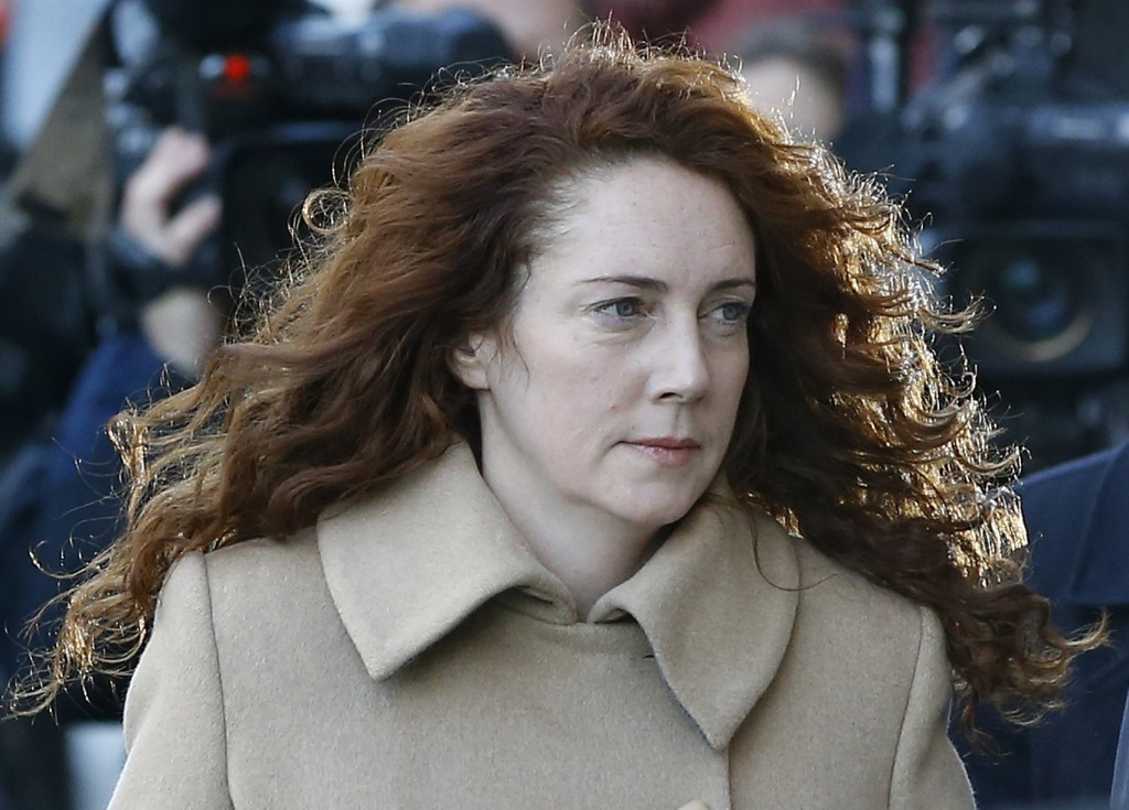 The Associated Press Rebekah Brooks arrives at The Old Bailey law court in London Monday. The former News of the World national newspaper editor and her colleague, Andy Coulson, are on trial on charges of hacking phones and bribing officials while at the now closed tabloid paper.