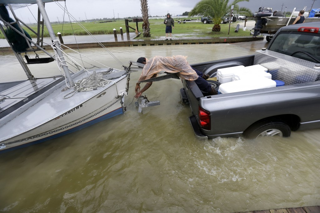 C.J. Johnson pulls a shrimp boat out of the water in preparation for the arrival of Tropical Storm Karen, at Myrtle Grove Marina in Plaquemines Parish, La., on Friday.