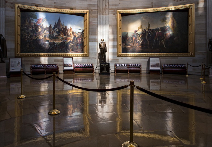 Normally filled with visitors and tourists, the empty Rotunda at the U.S. Capitol is seen in Washington, Tuesday, Oct. 1, 2013, after officials suspended all organized tours of the Capitol and the Capitol Visitors Center as part of the government shutdown. A statue of President Gerald R. Ford at center is illuminated amid large paintings illustrating the history of the United States.